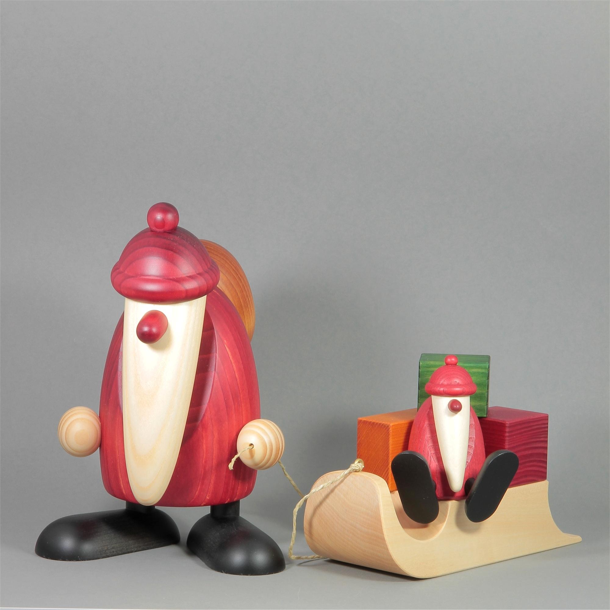 Weihnachtsmann mit Geschenkeschlitten und Kind, groß