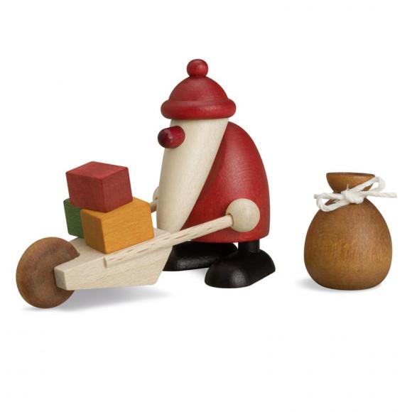 Weihnachtsmann mit Schubkarre und Sack