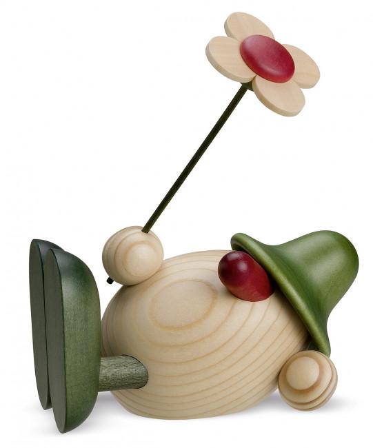 Eierkopf Oskar mit Blume liegend, grün