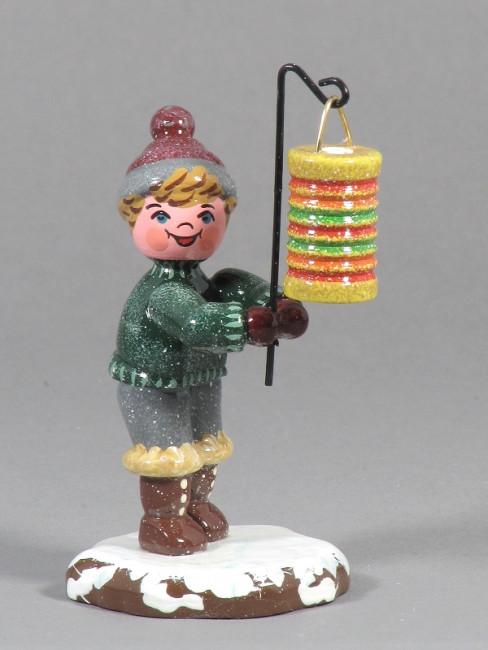 Winterkinder Junge mit runden Lampion