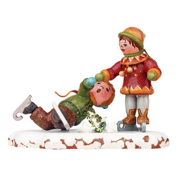 Winterkinder Schlittschuhläufer