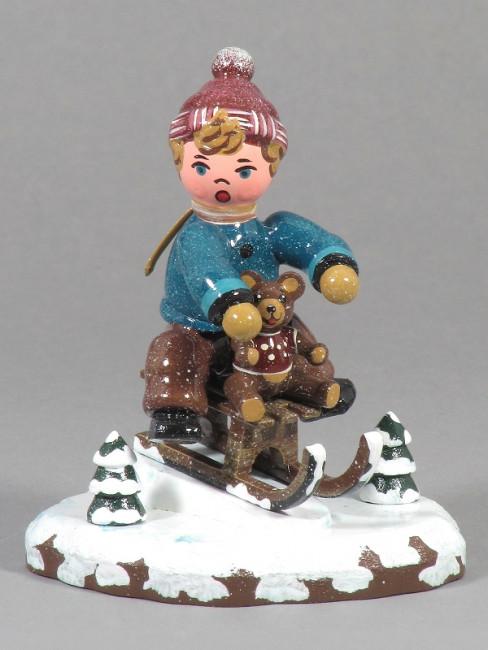 Winterkinder Schlittenfahrer