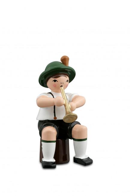 Musikant sitzend mit Trompete