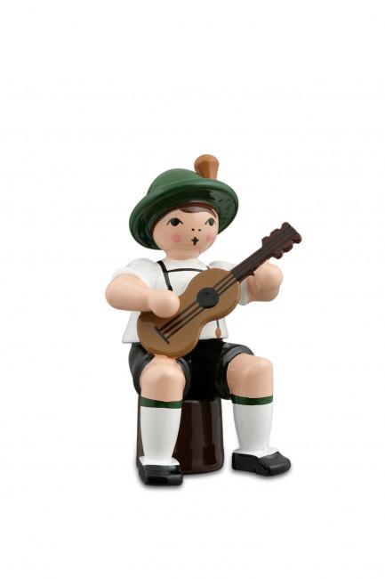 Musikant sitzend mit Gitarre