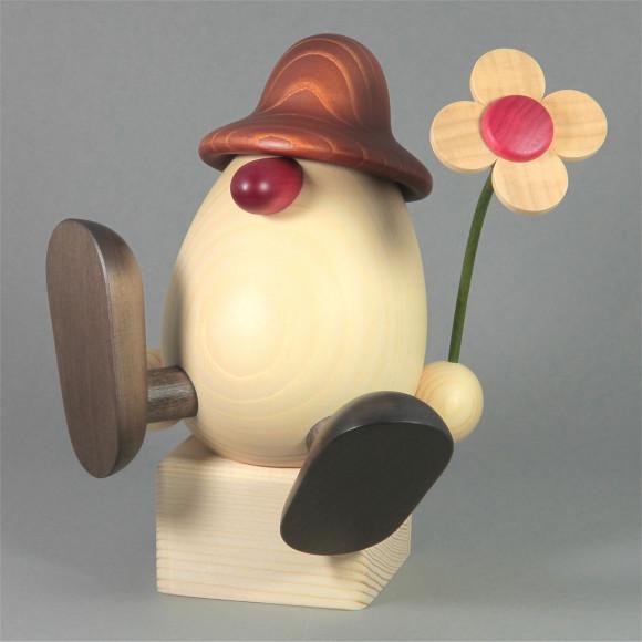 Eierkopf Vater Alfons mit Blume sitzend, groß, braun