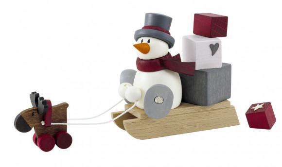 Schneemann Otto mit Geschenkeschlitten