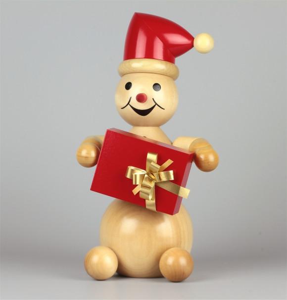 Schneemann mit roter Mütze sitzend, groß