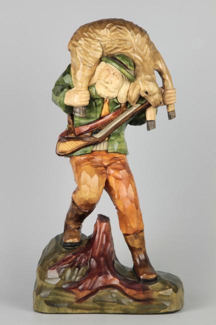 Geschnitzter Jäger mit Wild farbig, 42 cm
