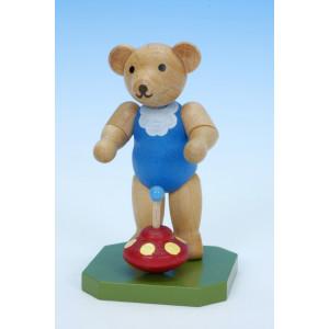 Spielzeugbär mit Brummkreisel