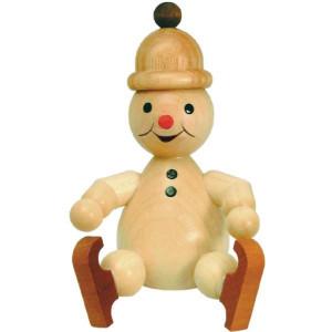 Schneemann Junior sitzend mit Schlittschuh, groß