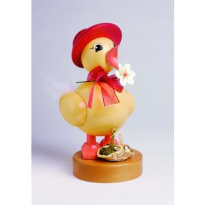 Frühlingsküken mit roten Hut