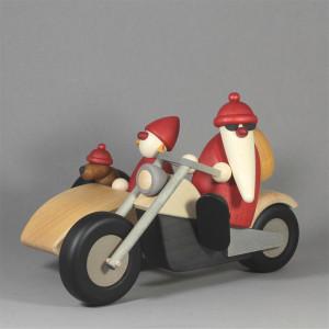Weihnachtsmann Familienausflug auf Motorrad mit Beiwagen