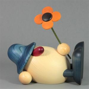 Eierkopf Vater Oskar mit Blume liegend, groß, blau