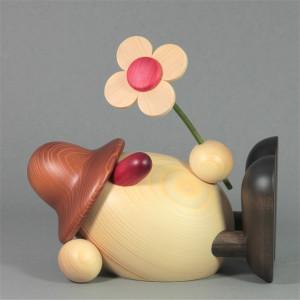 Eierkopf Vater Oskar mit Blume liegend, groß, braun