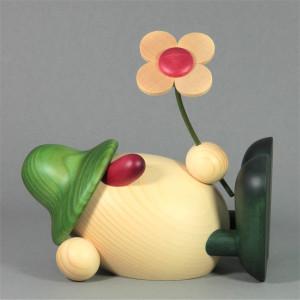 Eierkopf Vater Oskar mit Blume liegend, groß, grün