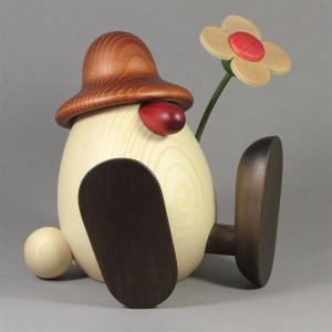 Eierkopf Vater Erwin mit Blume sitzend, groß, braun