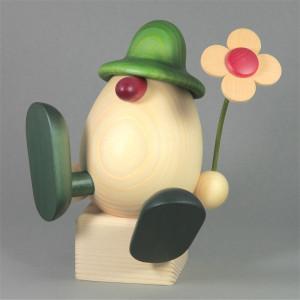 Eierkopf Vater Alfons mit Blume sitzend, groß, grün
