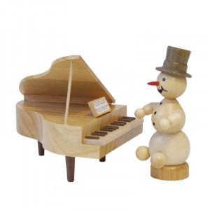 Schneemannmusikant am Flügel