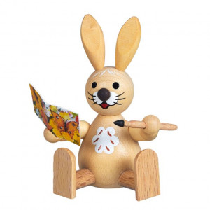 Osterhase mit Glückwunschkarte, sitzend