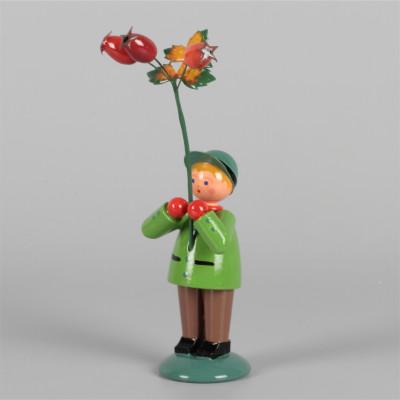 Blumenkind Herbstkind Junge mit Hagebutte