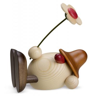 Eierkopf Oskar mit Blume liegend, braun