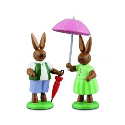 Hasenpaar mit Schirm