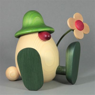 Eierkopf Vater Erwin mit Blume sitzend, groß, grün