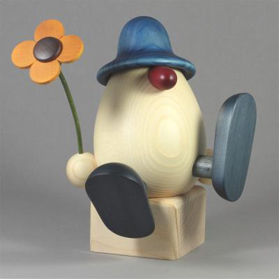 Eierkopf Vater Alfons mit Blume sitzend, groß, blau