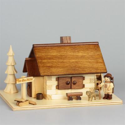 Räucherhaus Zur alten Mühle mit Figur