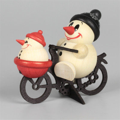 Cool-Man auf Fahrrad mit Kindlein