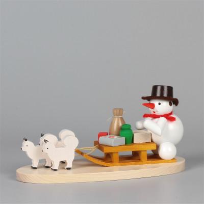Schneemann mit Hundeschlitten