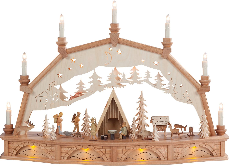 Bewegter Lichterbogen Schutzhütte mit Waldfiguren